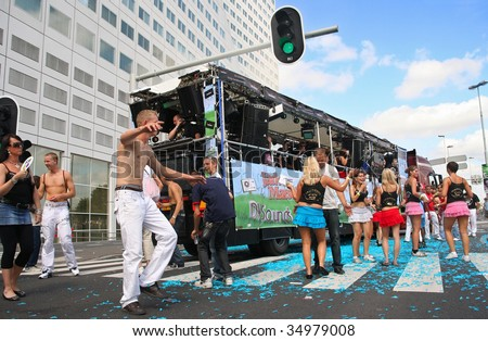 ROTTERDAM, HOLLAND - AUGUST 8, 2009: Participants in the annual Dance Parade (the world's biggest Electronic Dance Music parade) in Rotterdam on August 8, 2009 in Rotterdam, Holland