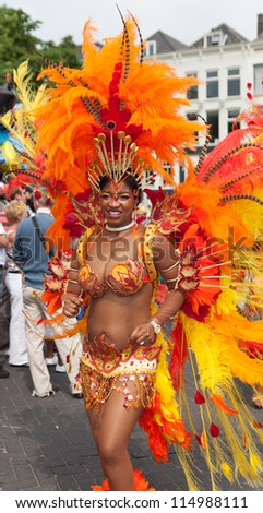 ROTTERDAM - JULY 28: Beautiful girl in a summer carnival parade on the 28th of July, 2012 in Rotterdam. The summer carnival is yearly event that attracts around 800.000 visitors.