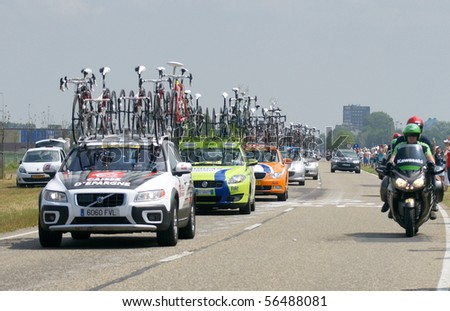 ROTTERDAM-JULY 4: Cars from various teams drive on during Stage 1 of the Tour de France from Rotterdam to Brussel on July 4 2010 in Rotterdam, Netherlands