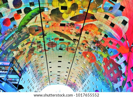 Rotterdam, Netherlands - August 24, 2016: the colourful painted arch ceiling of the Markthal - famous market hall in central Rotterdam Stockfoto ©