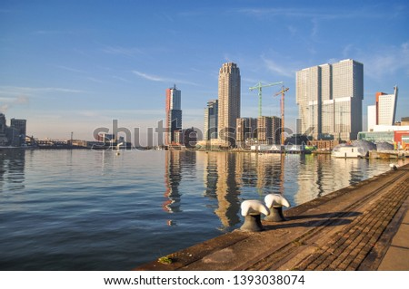 ROTTERDAM, NETHERLANDS: View on Port of Rotterdam business area, Netherlands during a sunny day.The river skyline of the Dutch city Rotterdam with houses and skyscrapers- Image