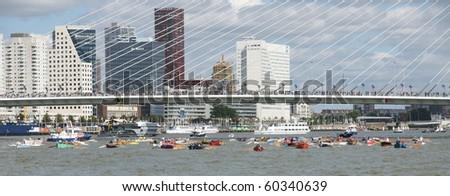 ROTTERDAM - SEPTEMBER 4: The World Port Days in Rotterdam showing rowing boats around the Erasmus bridge having a race on September 4 , 2010 in Rotterdam, Netherland