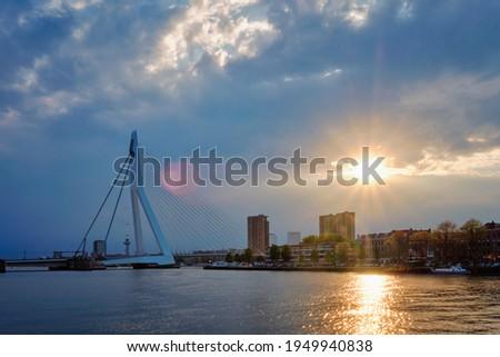Rotterdam skyline cityscape with Erasmusbrug bridge over Nieuwe Maas in contre-jur on sunset. Rotterdam, the Netherlands Photo stock ©