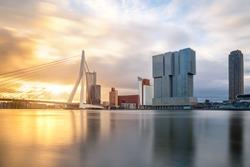 Rotterdam Skyline with Erasmusbrug bridge in morning in Rotterdam, Netherlands.