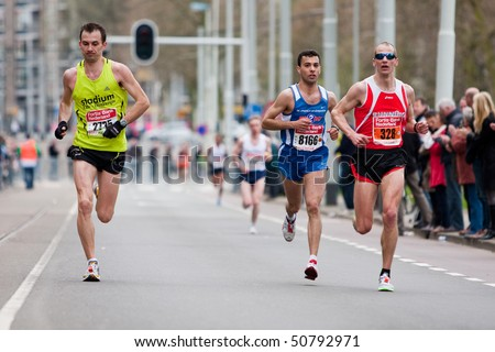 ROTTERDAM, THE NETHERLANDS - APRIL 11 : Annual Fortis Rotterdam Marathon. Runners on the city streets on April 11, 2010 in Rotterdam, The Netherlands.
