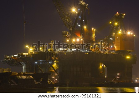 ROTTERDAM, THE NETHERLANDS – 11 FEBRUARY 2012: Cranes on top of the 'Balder', a deepwater construction vessel, 154m long and able to lift up to 6,300t in Rotterdam, on February 11, 2012.