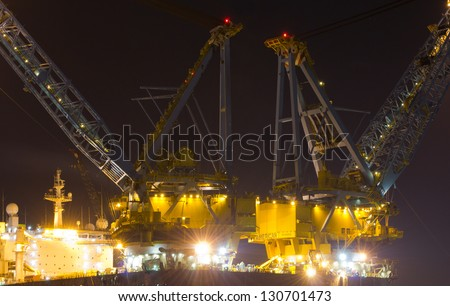 ROTTERDAM, THE NETHERLANDS, FEBRUARY 20: Cranes on top of the Saipem 7000, a deepwater construction vessel, 198m long and able to lift up to 7,000t in Rotterdam, on February 20, 2012.