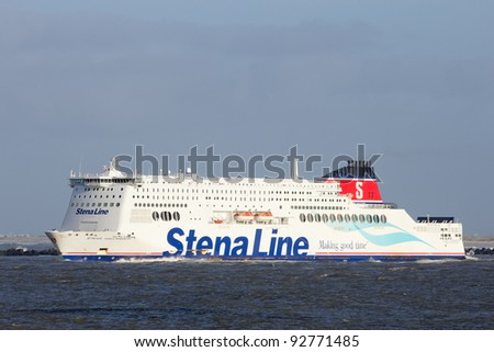 ROTTERDAM, THE NETHERLANDS - JAN 13: The Stena Hollandica leaves Hoek van Holland for Harwich, England on Jan 13, 2012 in Hoek, The Netherlands. Founded in 1962, Stena Line now operates 35 ships. - stock photo