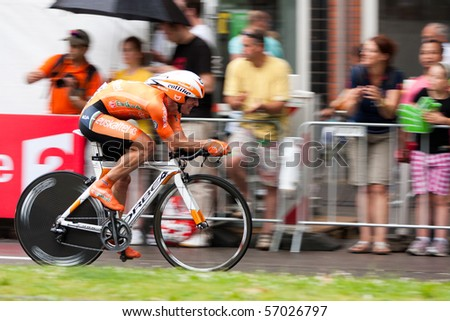ROTTERDAM, THE NETHERLANDS - JULY 3 : Tour de France - annual bicycle race. Cyclist during the first day of competition - prologue race on the city streets on July 3, 2010 in Rotterdam