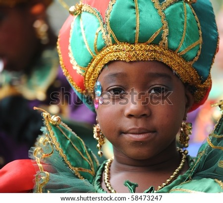 ROTTERDAM, THE NETHERLANDS - JULY 31: Unidentified young performer dressed as princess participates at the Summer Carnival in Rotterdam on july 31, 2010.The carnival attracts around 1 million visitors yearly