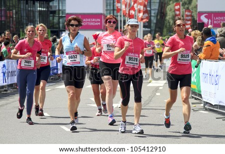 ROTTERDAM, THE NETHERLANDS - JUNE 10 2012: Group of competitors running in the annual Ladiesrun 10 KM event held on Sunday June 10,  2012 in Rotterdam.