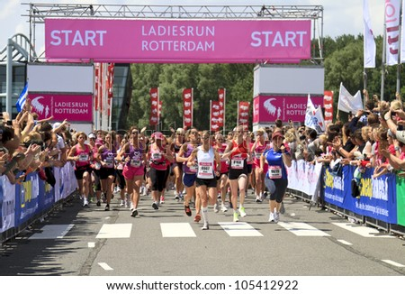 ROTTERDAM, THE NETHERLANDS - JUNE 10 2012: Runners sprint off the start line in the annual Ladiesrun 10 KM event held on Sunday June 10,  2012 in Rotterdam.
