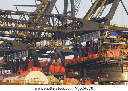 ROTTERDAM, THE NETHERLANDS - 15 MARCH 2012: Cranes on top of the Thialf, Heerema's largest deep-water construction vessel (DCV), 165m long and can lift up to 7,100t in Rotterdam, on March 15, 2012