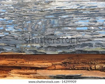 Rotting wood. Peeling paint. - stock photo