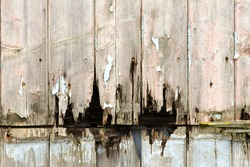 rotting wooden panels crumbling with decay