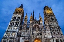 Rouen Cathedral (Cathedrale de Notre-Dame) in Rouen, capital of Haute-Normandie. The facade of the Gothic church building in blue hours. Travel France.