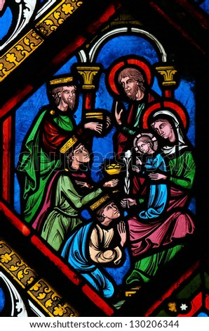 ROUEN - FEBRUARY 10: Stained glass depicting the three kings from the East who visit the Holy Family in Bethlehem,  in the cathedral of Rouen, France, on February 10, 2013.