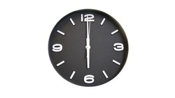 Rough and grainy black faced wall clock isolated on white background showing time at six o'clock
