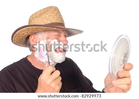 rough and tough cowboy shaving face with bowie knife