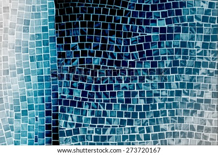 rough blue mosaic tile wall in bathroom