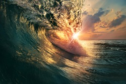 rough colorful ocean breaking surf wave falling down at sunset time
