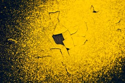 Rough dark black wall with yellow sprays of dye. Colorful background closeup. Dark black texture of concrete wall surface with yellow spots of paint. Painted backdrop. Exfoliated paint. Flaking stucco