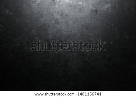 Rough, dark stone background lit by spotlight background