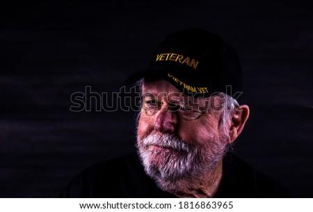 Rough Looking Vietnam Vet With Scraggly Beard Stock foto ©