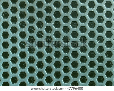 Rough metal surface with small dark hexagons