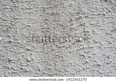 Rough, rough concrete surface. Texture of cement. White background