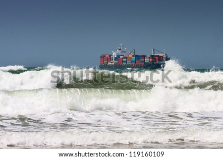 Rough sea with container ship in the background