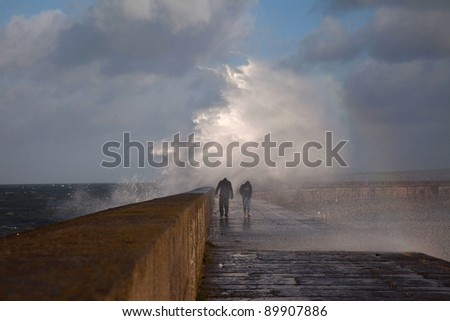 Rough seas at Holyhead Breakwater off the coast of Isle of Anglesey North Wales