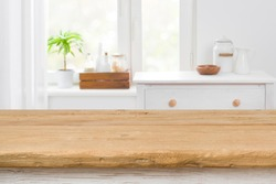 Rough texture table for product display before blurred kitchen window