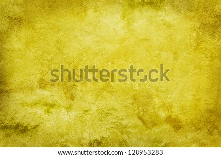 Rough textured wall in yellow.
