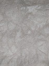 Rough unpainted concrete house wall