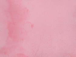 Rough wall background, painted with pink paint. Abstract texture. Can be used for layout or placement of text and images. Close-up. Detail of architecture, construction and masonry.