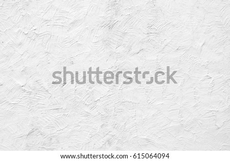 Rough white painted rendering on exterior wall #615064094