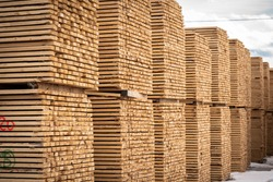 Rough 2x4 spruce and pine SPF lumber piled at a sawmill