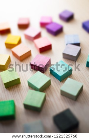 Roughly placed colorful wooden blocks with beautiful colors. All different colors. Extremely shallow depth of field.Roughly placed colorful wooden blocks with beautiful colors. All different colors. #1221325768