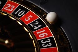 Roulette ball on number twentyfour
