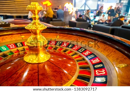 Roulette. Casino. A table with a tape measure. Roulette wheel in a casino. Bets on gambling. Luck. Cash games. Gambling in the United States. Lose money
