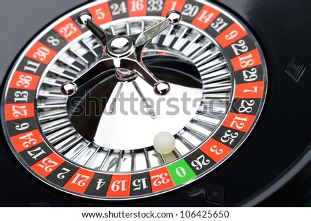 Roulette wheel in casino closeup. High detailed photo