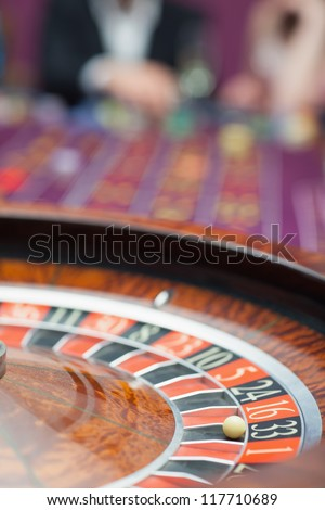 Roulette wheel in motion at casino