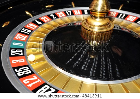 Roulette wheel with ball on number 3