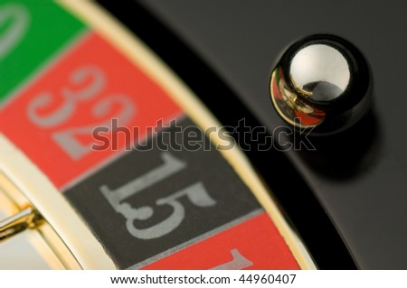 Roulette with rolling ball over number 15