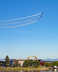 Roulettes performing an aerobatic display  over Lake Burley Griffin during an aerial fly over event in Canberra to mark 100 years of the Royal Australian Air Force