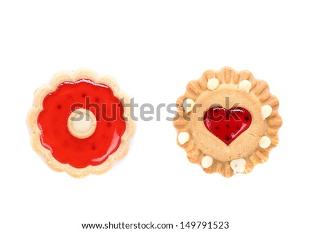 Round and heart shaped strawberry biscuit. Close up. White background.
