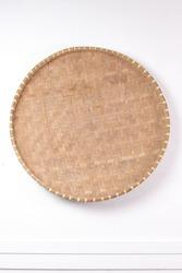 Round bamboo wall art, natural. tampah bambu, a typical Indonesian handicraft