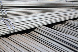 Round bar steel pile up together, closeup of photo