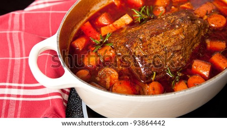 Round Beef Roast Prepared with Carrots and Yams in French Oven